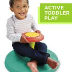 toddle boy on sit and spin toy - Wonderful World of Bree