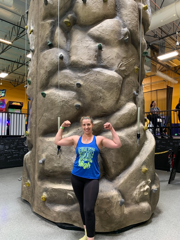 woman in front of rock climbing wall