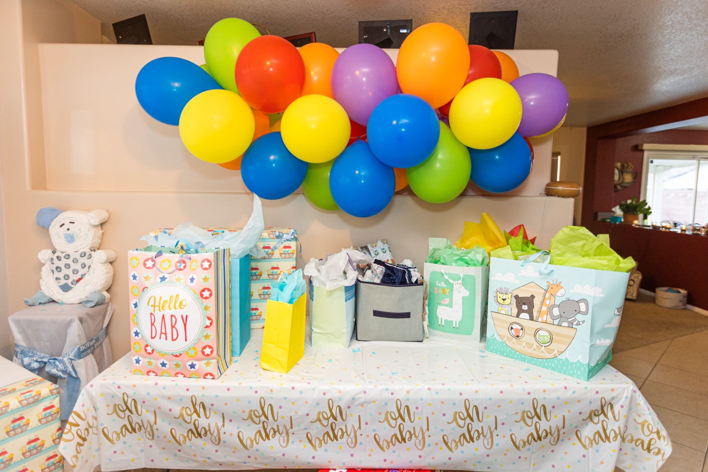 How to Host a Sprinkle Baby Shower, balloon are and gift table